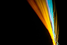 Colorful light streaks on black background