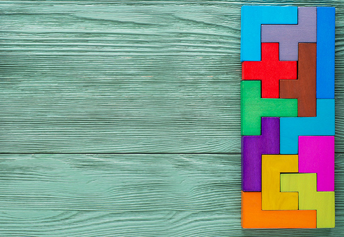 Colorful tetris blocks joint wooden background