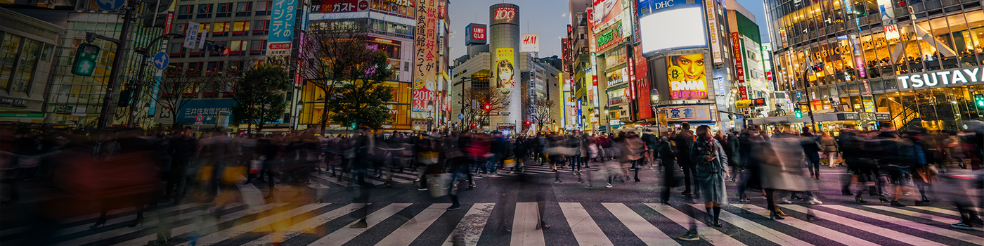 Pedestrians walking across with crowded traffic at Shibuya crossing square, Japan