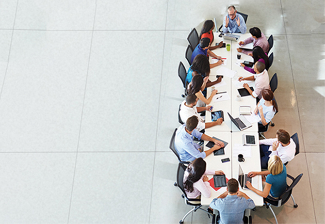 Top-view of business people in meeting at round-table