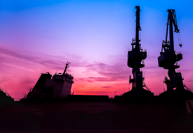 Industrial machines at dusk