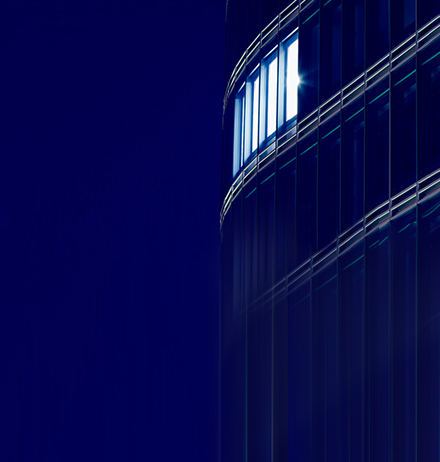 Curved blue glass building