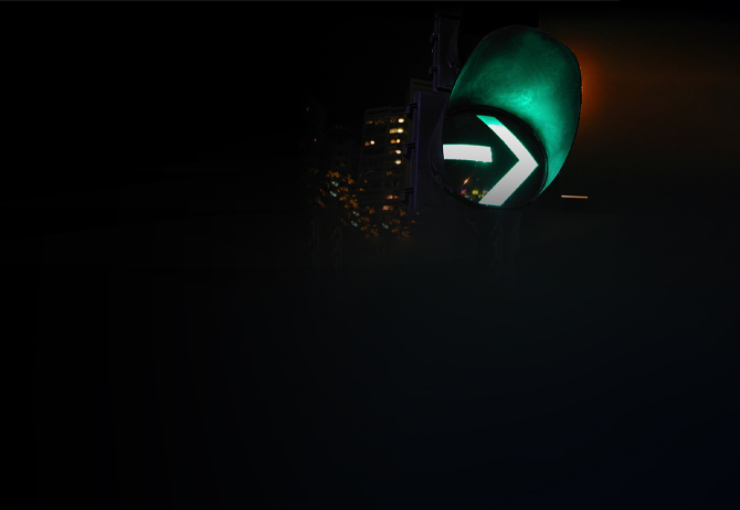 Green traffic signal light at night