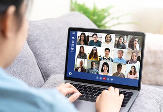 Person on conference video call on laptop