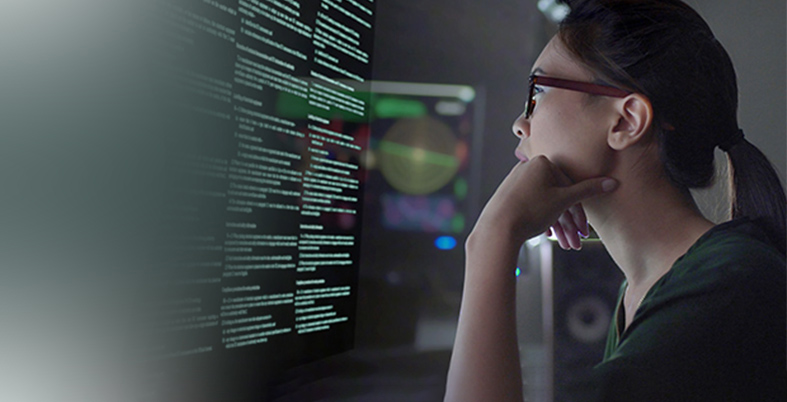 Women wearing spectacles working on computer