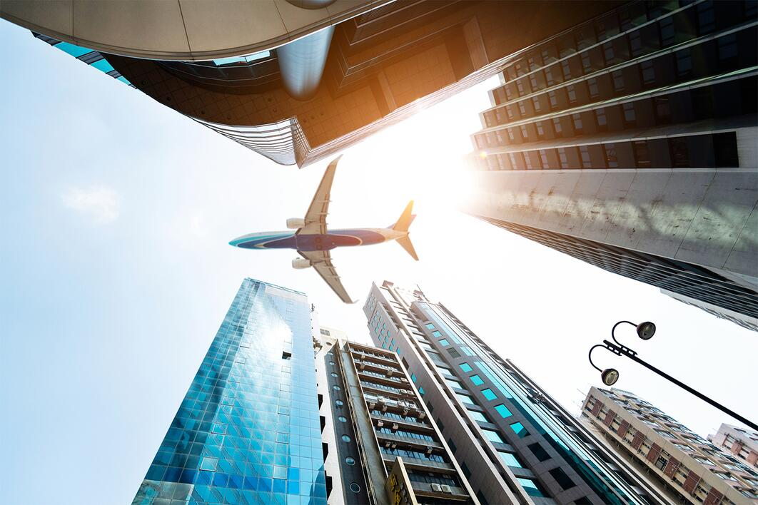 Aeroplane passing above buildings