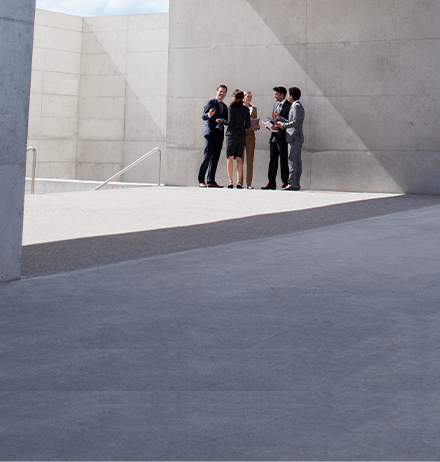 Business people standing under roof discussing