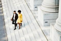 Man and woman walking down stairs together