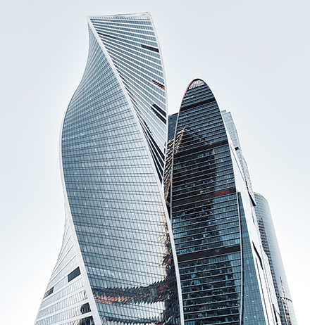 Two abstract shape glass building together