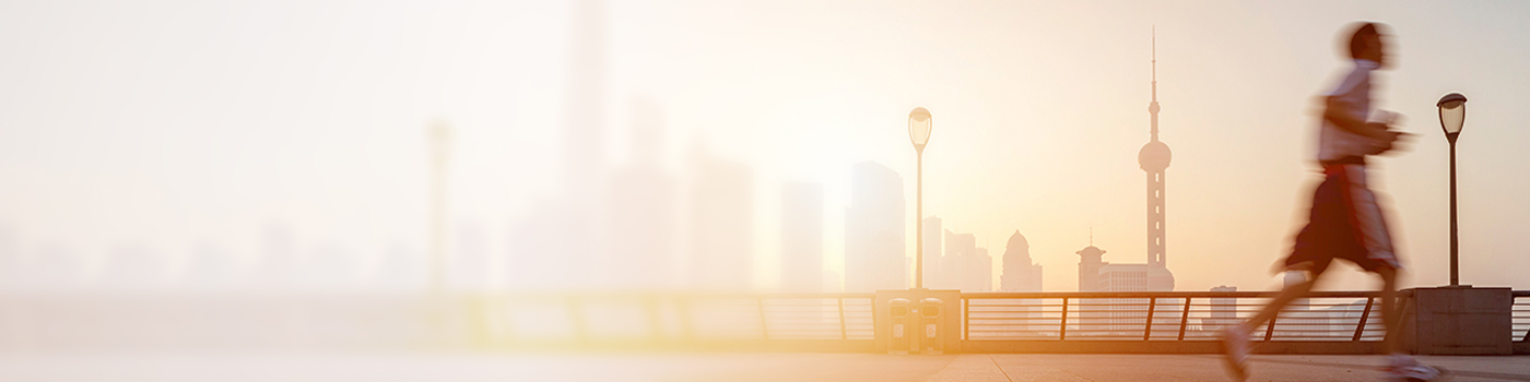 Man jogging in bright morning with city background