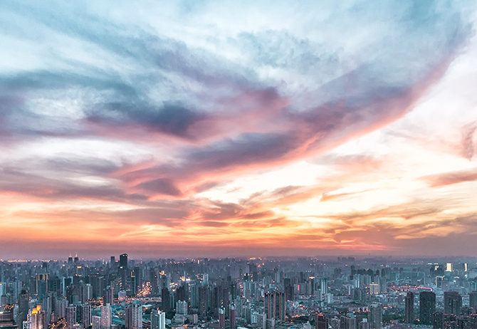 Wide angle evening sky view with city buildings