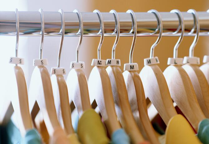 Shirts on hangers in store, close-up