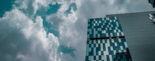 Glass building with clouds