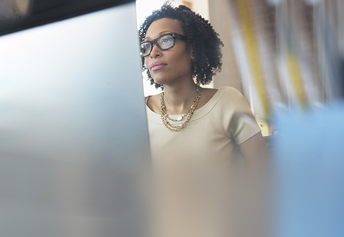 Businesswoman wearing spectacles working at computer