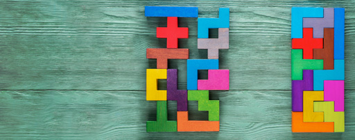 Colorful tetris blocks placed on wooden table