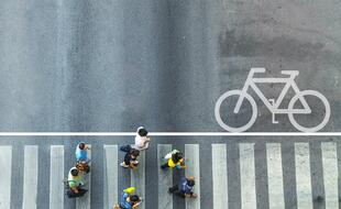 People crossing road bike
