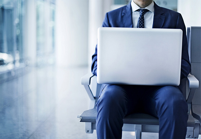 Man sitting working on laptop