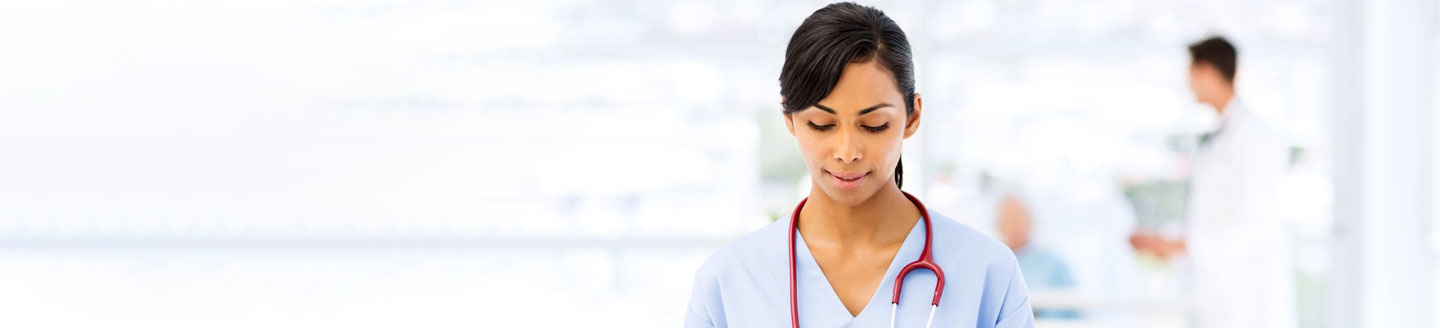 doctor-wearing-stethoscope-holding-tablet-with-blur-background