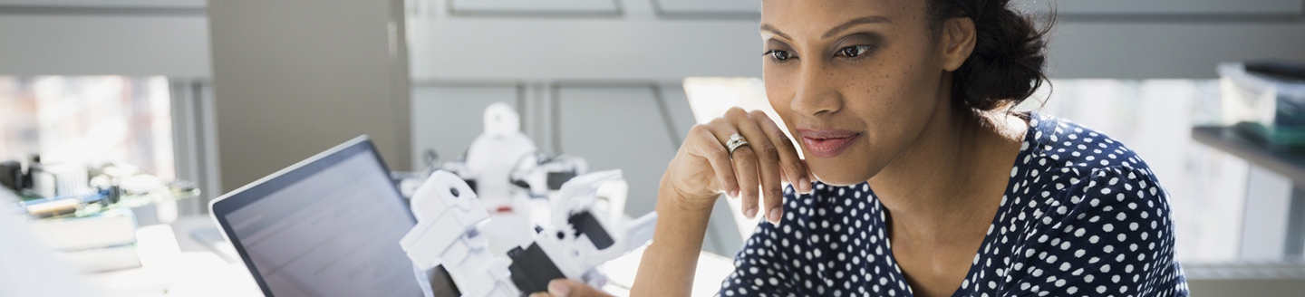Women looking at robot technology in laboratory