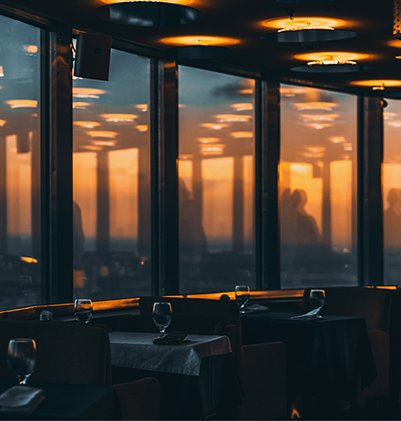 City view from a high rise restaurant building at night