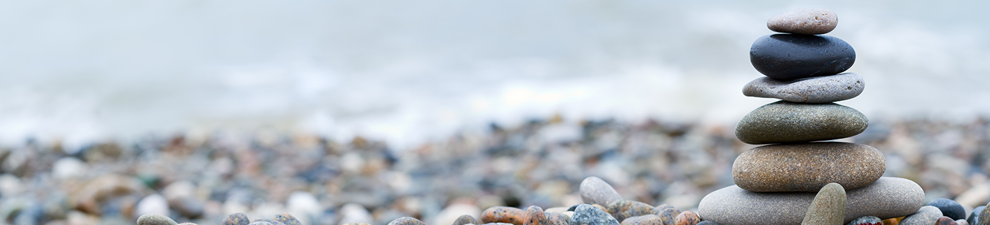 Colourful pebbles on top of each other