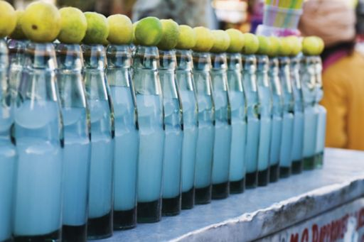 KPMG IFRS 15 for food, drink and consumer goods (FDCG) companies: soft drink bottles on a shelf