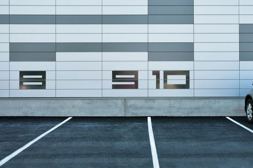 8, 9 space on the parking lot wall