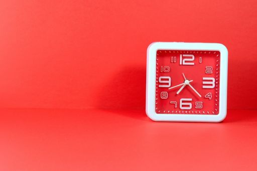 Analogue clock on red background