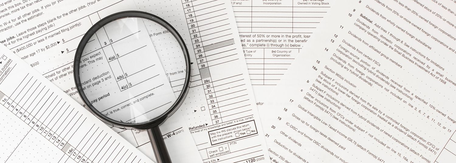 looking glass on tax papers