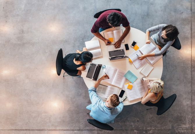 Employees working together in office