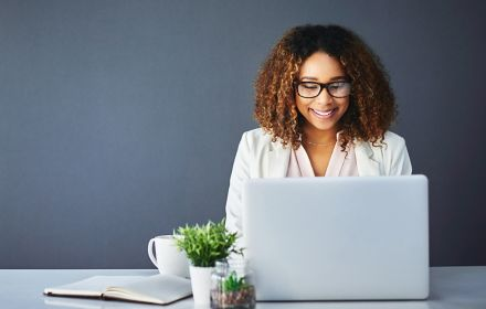 Woman checking laptop for events