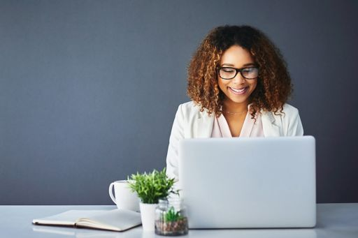 Women checking laptop for events
