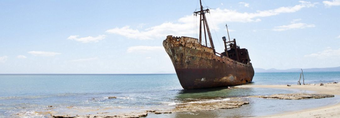 KPMG IFRS Newsletter: Impairment publication image: rusting hull of a ship on a beach