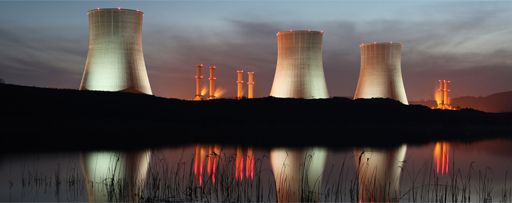 KPMG IFRS 15 (new revenue standard) for power and utilities image: A thermal power station next to a body of water.