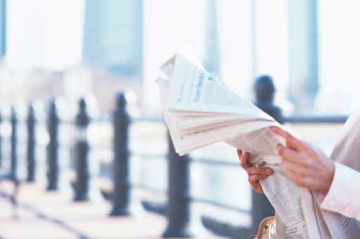 KPMG IFRS breaking news image: person reading financial newspaper