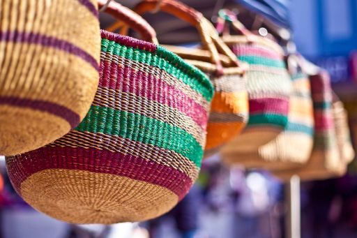 KPMG IFRS revenue topic image: colourful wicker baskets hanging on a market stall