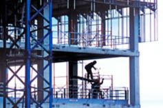 KPMG IFRS Conceptual Framework topic image: workers on a building site scaffold.