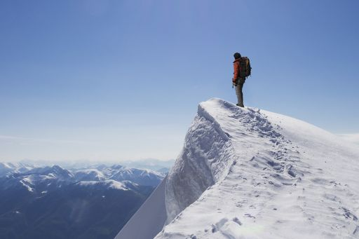 Agenda consultation topic image - Climber on summit of snow capped mountain
