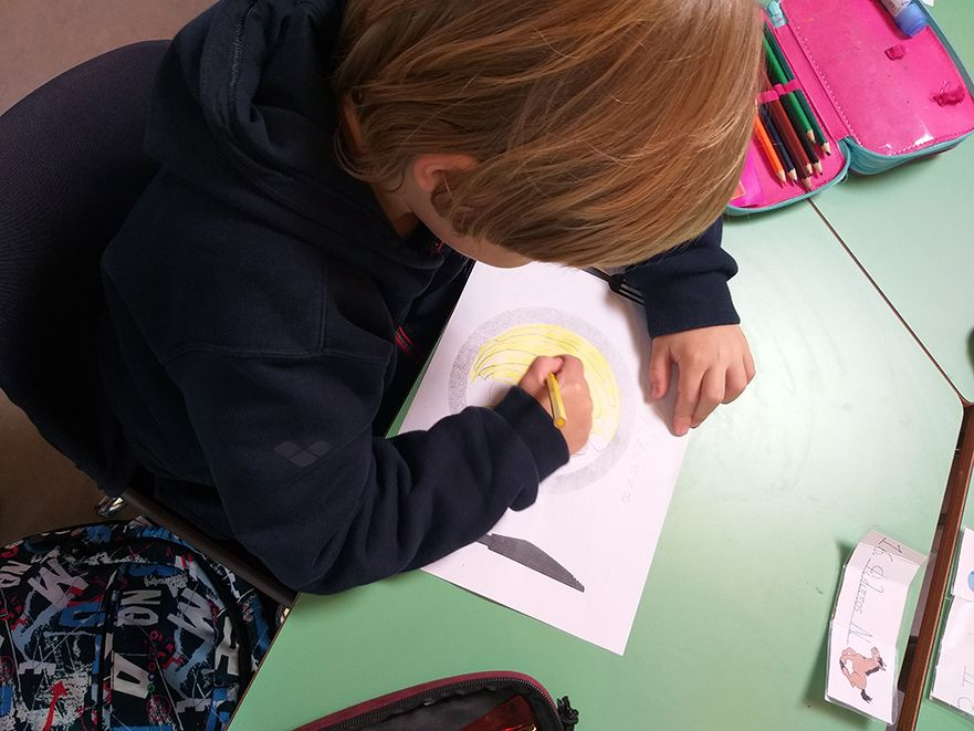 a child painting a drawing