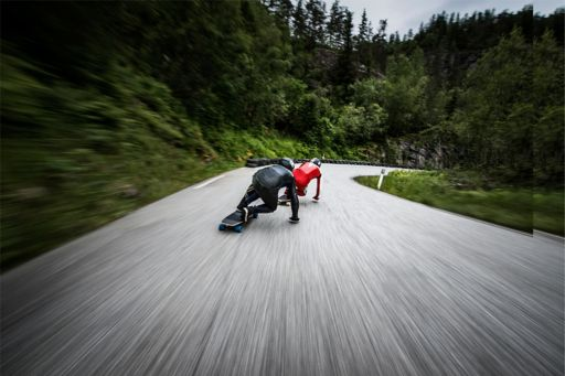 longboarders going downhill