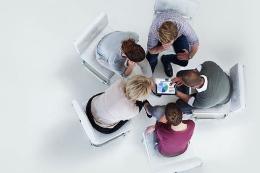 Meeting around small desk