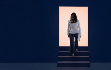 Woman walking through KPMG Rectangle
