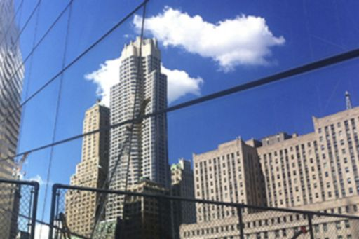 buildings reflect on the glass