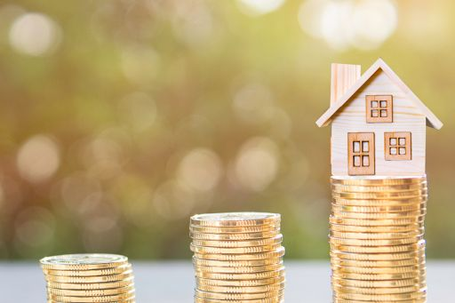 House with coins representing real estate taxation
