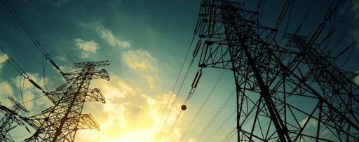 High-voltage power transmission towers in sunset sky background, 130656938