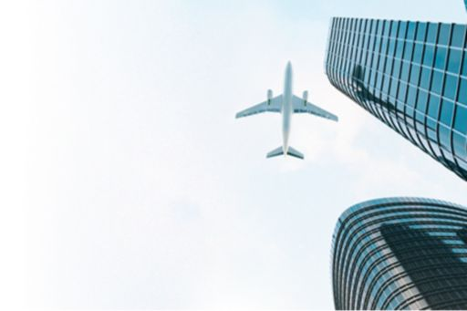Building with airplane flying