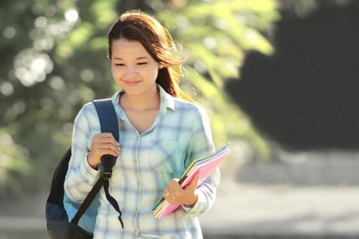 student-carrying-books