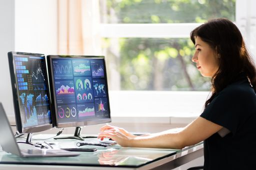 woman looking at tax dashboards