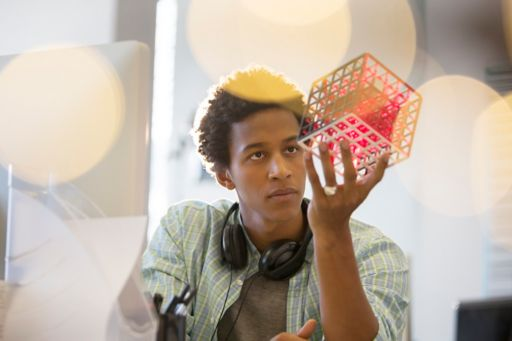 young man looking for a cube