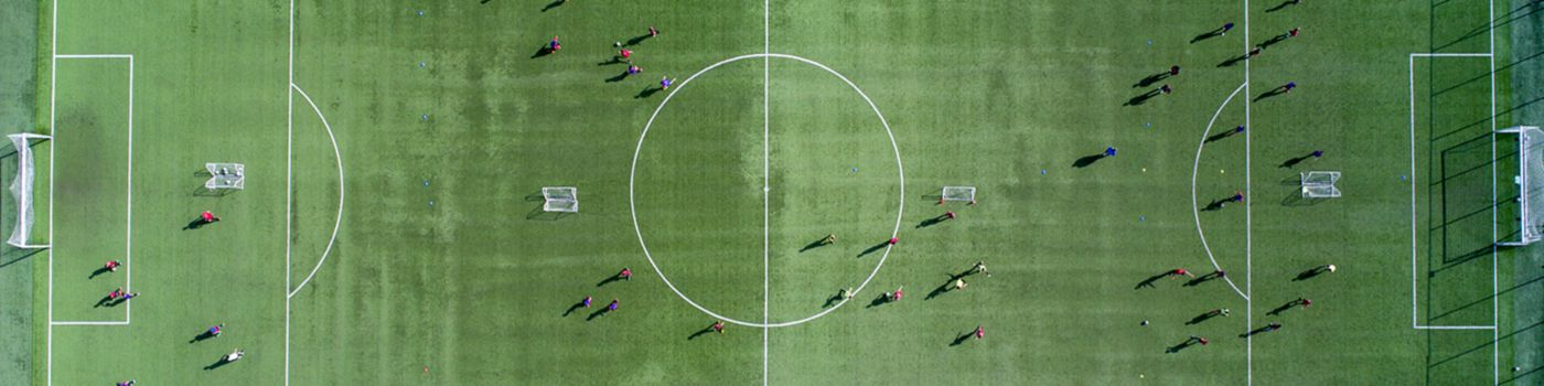 Aerial view of a soccer, football match. Football field and Footballers